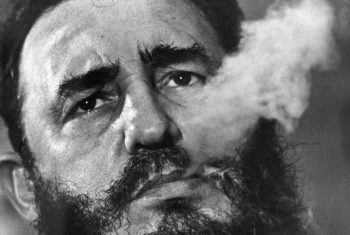 ** FILE ** Cuban Prime Minister Fidel Castro exhales cigar smoke during an interview at his presidential palace in Havana in this March, 1985, file photo taken by Associated Press photographer Charles Tasnadi. Tasnadi, who braved minefields and barbed wire to escape communist Hungary and went on to spend three decades as a top Associated Press photographer, died Thursday, Jan. 10, 2008, following a stroke. Famed for his skills as a photographer and revered as a great gentleman, Tasnadi was born Karoly Tasnadi on March 1, 1925 in Ajka, Hungary. (AP Photo/Charles Tasnadi, file)